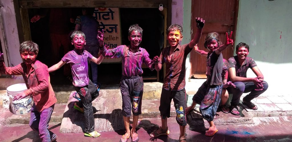 festival of colors kids playing with nomadic nava